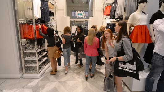 Customers browse inside a Hennes & Mauritz AB (H&M) fashion store in Melbourne, Australia.
