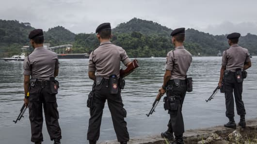 Indonesian police stand guard as the Bali Nine duo Andrew Chan and Myuran Sukumaran arrive at Wijaya Pura Port where they will be transferred to Nusa Kambangan prison ahead of their execution on March 4, 2015 in Cilacap, Central Java, Indonesia.