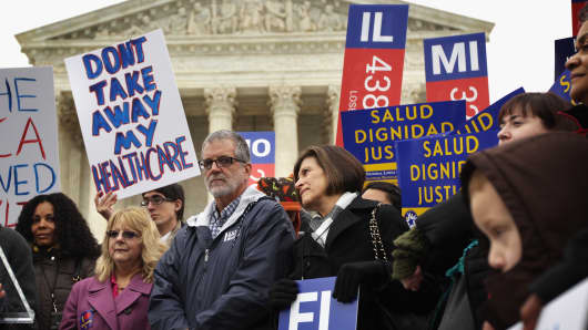 Supporters of the Affordable Care Act gather in front of the U.S Supreme Court during a rally March 4, 2015 in Washington, DC.