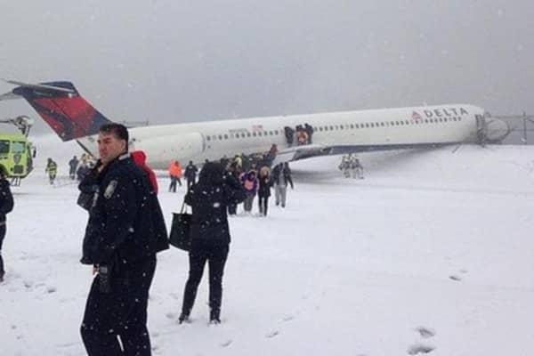 Delta jet slides off runway at LGA