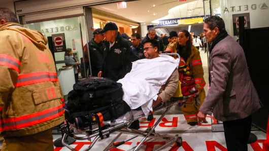 A passenger is wheeled on a stretcher through Terminal D by emergency medical services workers at LaGuardia Airport in New York March 5, 2015.