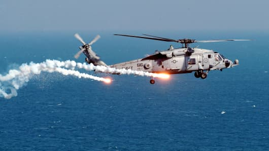 An HH-60H Seahawk of Helicopter Anti-Submarine Squadron Seven (HS-7), test dispense flares and chaff from the on board AN/AAR-47 system.