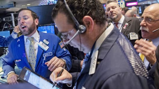 Traders work on the floor of the New York Stock Exchange, March 5, 2015.
