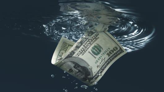 $100 bill sinking in water