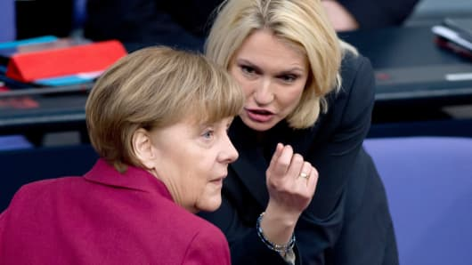 Manuela Schwesig (R), German Minister of Family Affairs, Senior Citizens, Women and Youth, speaks with German Chancellor Angela Merkel during a session at the Bundestag (lower house of parliament) on March 5, 2015 in Berlin.