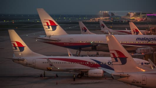 Ground staff prepare Malaysia Airlines planes for departure at Kuala Lumpur International Airport in Sepang
