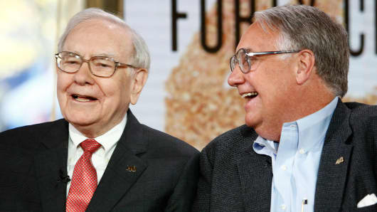 Warren Buffett, left, and his eldest son, Howard G. Buffett