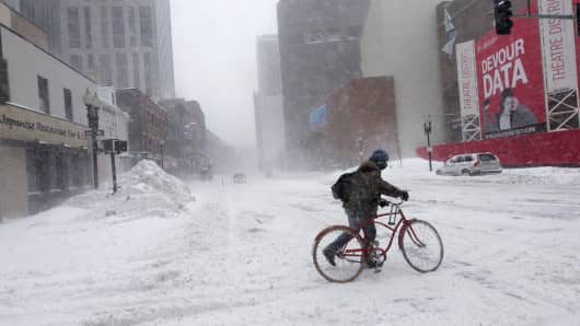 A man trying to ride his bicycle in Boston last month.
