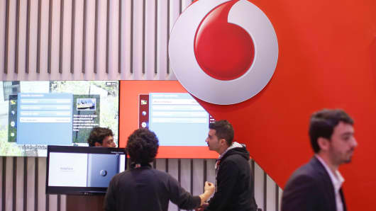 Attendees visit the Vodafone Group pavilion at the Mobile World Congress in Barcelona, Spain, March 4, 2015.