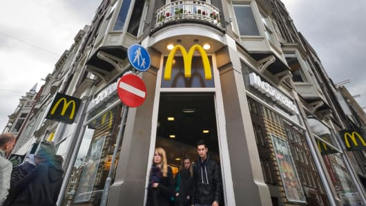 Customers exit a McDonald's restaurant in Amsterdam, Netherlands.