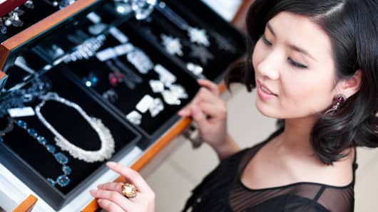 Asian woman jewelry shopping