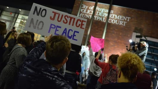Protesters demonstrate outside the Ferguson Police Department on March 11