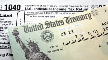 Treasury check and 1040 tax form