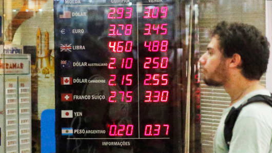 A board shows U.S. dollar exchange rates in Rio de Janeiro.