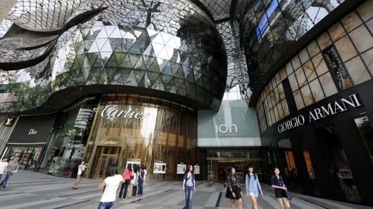 Pedestrians walk outside the Ion Orchard mall in Singapore