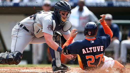 ose Altuve of the Houston Astros is tagged out at home plate by James McCann of the Detroit Tigers on March 12, 2015 in Kissimmee, Florida.