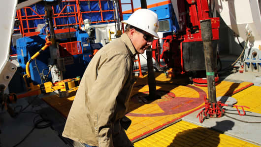 A worker with Apache in the Permian Basin in Mentone, Texas.
