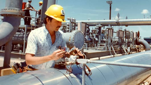 A technician inspects a gauge on a meter station at the Strategic Petroleum Reserve's Bryan Mound sit