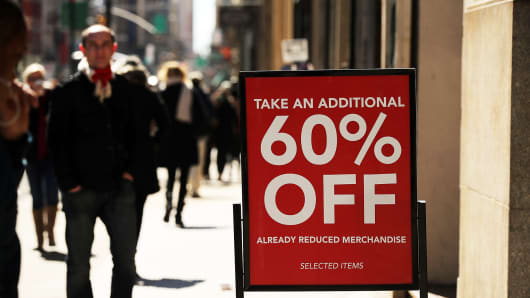 A sale sign outside a clothing store in New York City