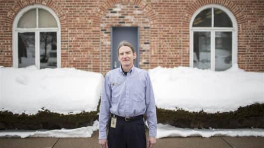 Steve Newberg outside the post office where he works in Farmington, Conn.