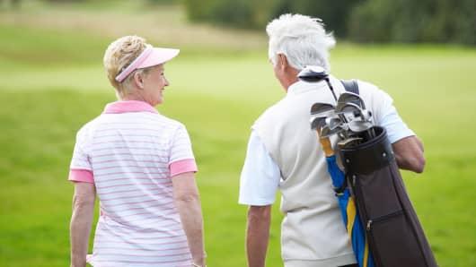 Seniors retirement couple golf