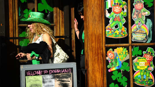 St Patrick's Day revelers leave a pub after attending St Patrick's Day parade on Fifth Avenue in New York.