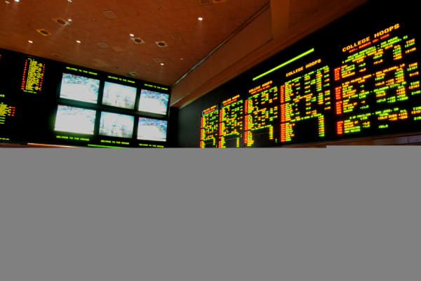 The Mirage Resort Race and Sports Book in Las Vegas is shown crowded with basketball fans during NCAA March Madness Tournament  in Las Vegas.
