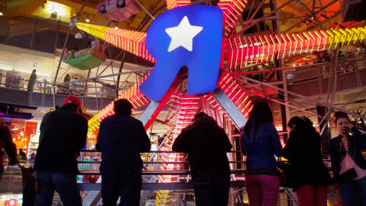 Shoppers watching the ferris wheel at the Toys R Us store in New York City.
