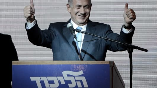 Israeli Prime Minister and Likud Party leader Benjamin Netanyahu greets supporters after the first results of the Israeli general election.