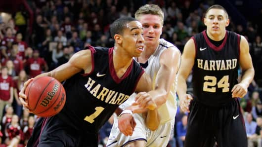 Siyani Chambers #1 of the Harvard Crimson during a game against the Yale Bulldogs, March 14, 2015 in Philadelphia.
