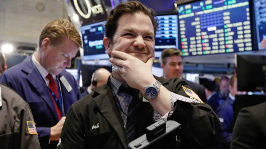 Trader Christopher Lotito, center, works on the floor of the New York Stock Exchange, March 19, 2015.