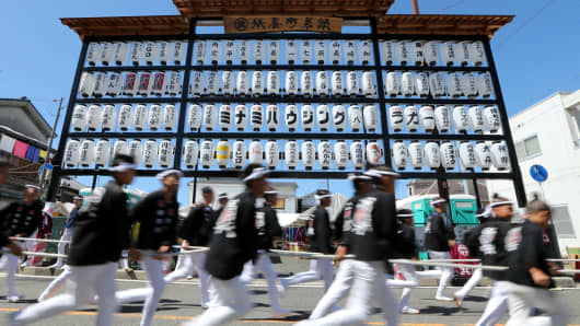 Men pull their portable shrine through the town of Kishiwada in Kishiwada, Japan.