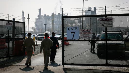 A file photo of workers entering an Exxon Mobil refinery