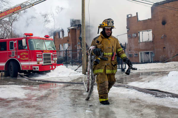 Firefighters battle an apartment fire in Detroit, March 5, 2014.