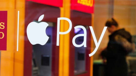 A sign for Apple Pay at a Wells Fargo bank branch in New York.