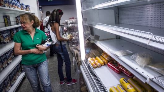 Women shop at a private-sector grocery store in Caracas, Venezuela in February.