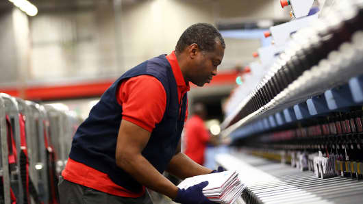 An employee sorts envelopes at Royal Mail in Northampton, England.
