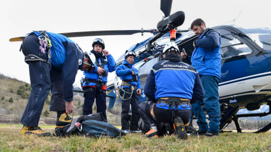 In this handout image provided by French Interior Ministry, rescue workers and gendarmerie continue their search near the site of the Germanwings plane crash on March 25, 2015 in La Seyne les Alpes, France.