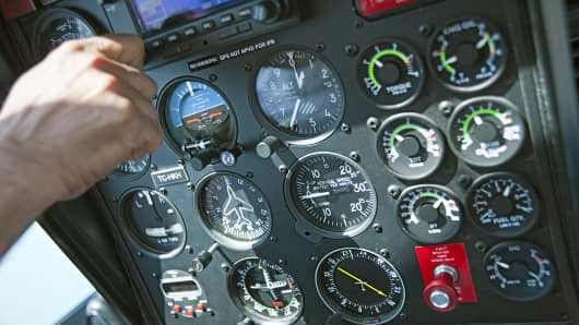 Pilot at controls of instrument panel