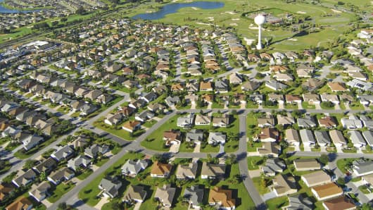 Aerial view of new homes and golf course in The Villages, Florida.