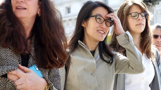 Ellen Pao, center, leaves the San Francisco Superior Court Civic Center Courthouse with her attorney, Therese Lawless, left, during a lunch break in San Francisco.