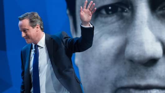 British Prime Minister David Cameron waves during the filming of 'Cameron & Miliband: The Battle For Number 10'