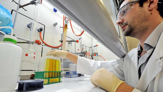 A researcher works in a laboratory of French biopharmaceutical company Genfit, in Loos, northern France, Nov. 15, 2012.