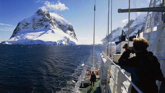 A research vessel sailing the Lemaire Channel, Antarctic Peninsula, Antarctica.
