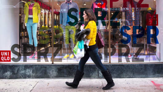 A shopper walks past a Uniqlo store in Philadelphia