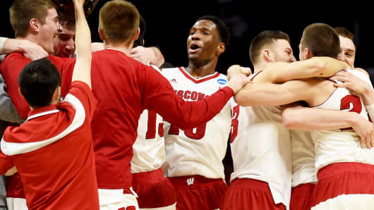 The Wisconsin Badgers celebrate after their win in the NCAA West Regional Final on March 28, 2015, in Los Angeles.