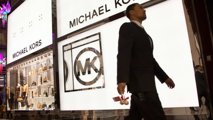 A pedestrian passes a Michael Kors store in New York