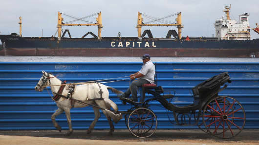 A tourist buggy is drawn by a horse in Havana, Cuba
