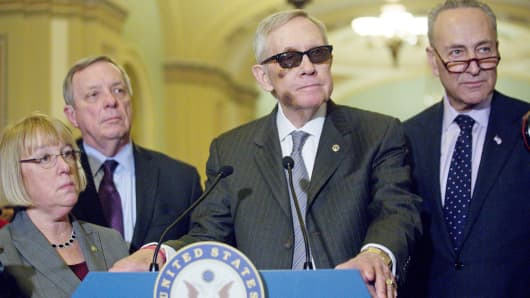 Senate Minority Leader Harry Reid, D-Nev., center, listens to a question during a news conference on Capitol Hill with, from left, Sen. Patty Murray, D-Wash., Sen. Dick Durbin, D-Ill., and Sen. Charles Schumer, D-N.Y., in Washington, Feb. 24, 2015.