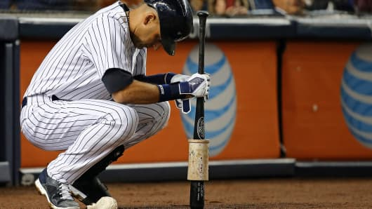 New York Yankees' Derek Jeter is in the on-deck circle during a game against the Baltimore Orioles in New York, Sept. 25, 2014.